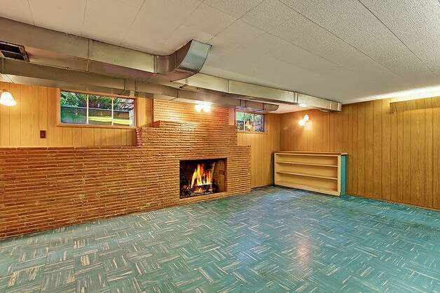 Rec room of 6833 32nd Ave. N.E. The 2,540-square-foot house, built in 1950, has four bedrooms, two bathrooms, a jetted tub and a backyard deck on a 4,000-square-foot lot. It's listed for $539,000. Photo: Courtesy Kelland And Eileen Lindsey/Windermere Real Estate
