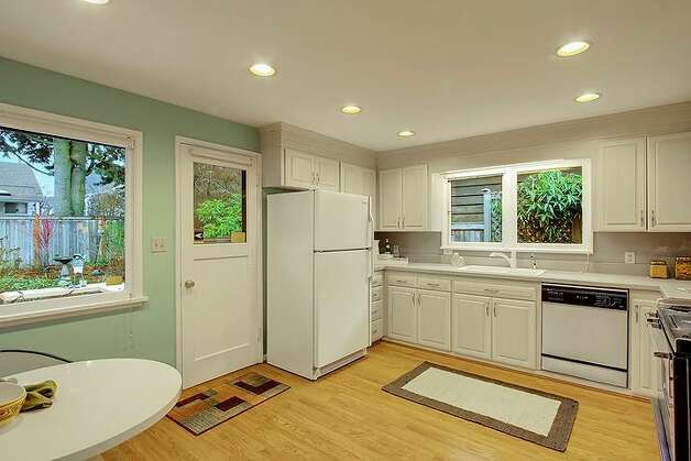 Kitchen of 6833 32nd Ave. N.E. The 2,540-square-foot house, built in 1950, has four bedrooms, two bathrooms, a rec room with a fireplace, a jetted tub and a backyard deck on a 4,000-square-foot lot. It's listed for $539,000. Photo: Courtesy Kelland And Eileen Lindsey/Windermere Real Estate