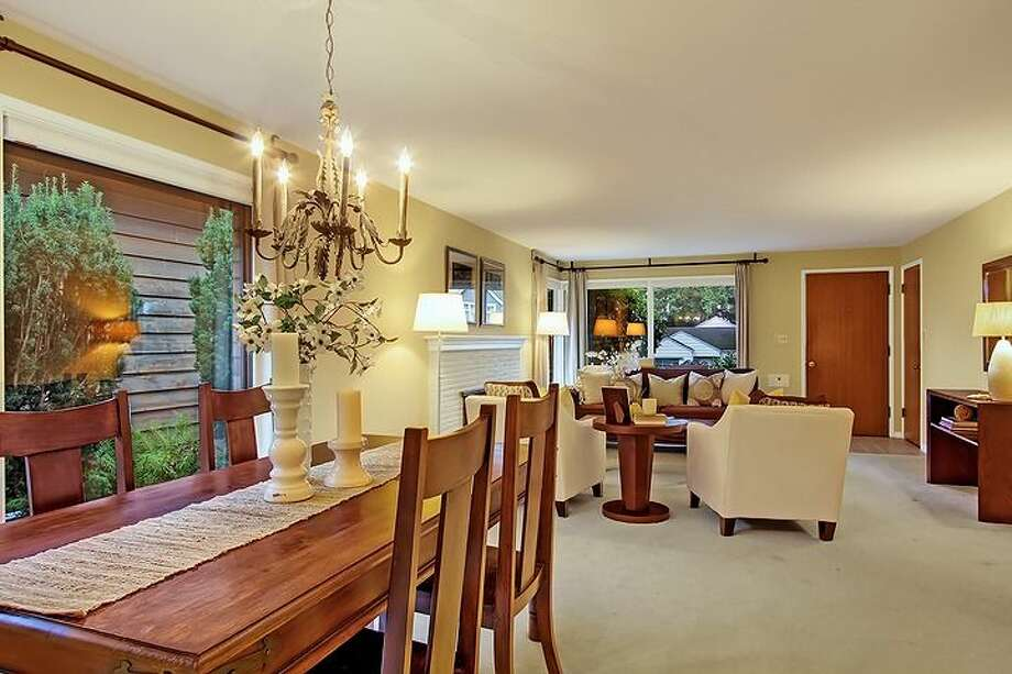 Dining room of 6833 32nd Ave. N.E. The 2,540-square-foot house, built in 1950, has four bedrooms, two bathrooms, a rec room with a fireplace, a jetted tub and a backyard deck on a 4,000-square-foot lot. It's listed for $539,000. Photo: Courtesy Kelland And Eileen Lindsey/Windermere Real Estate