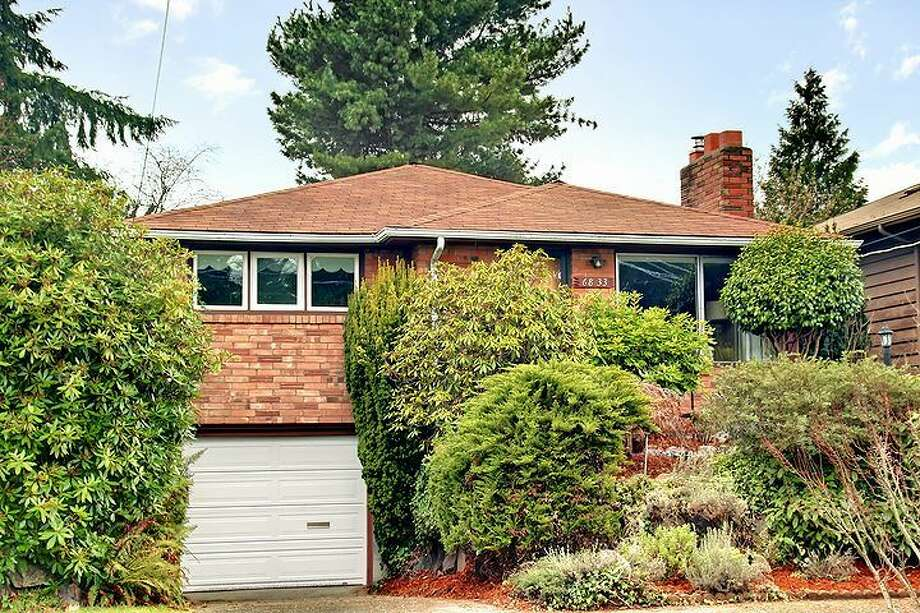 We'll end with the priciest home on our tour, 6833 32nd Ave. N.E. The 2,540-square-foot house, built in 1950, has four bedrooms, two bathrooms, a rec room with a fireplace, a jetted tub and a backyard deck on a 4,000-square-foot lot. It's listed for $539,000. Photo: Courtesy Kelland And Eileen Lindsey/Windermere Real Estate