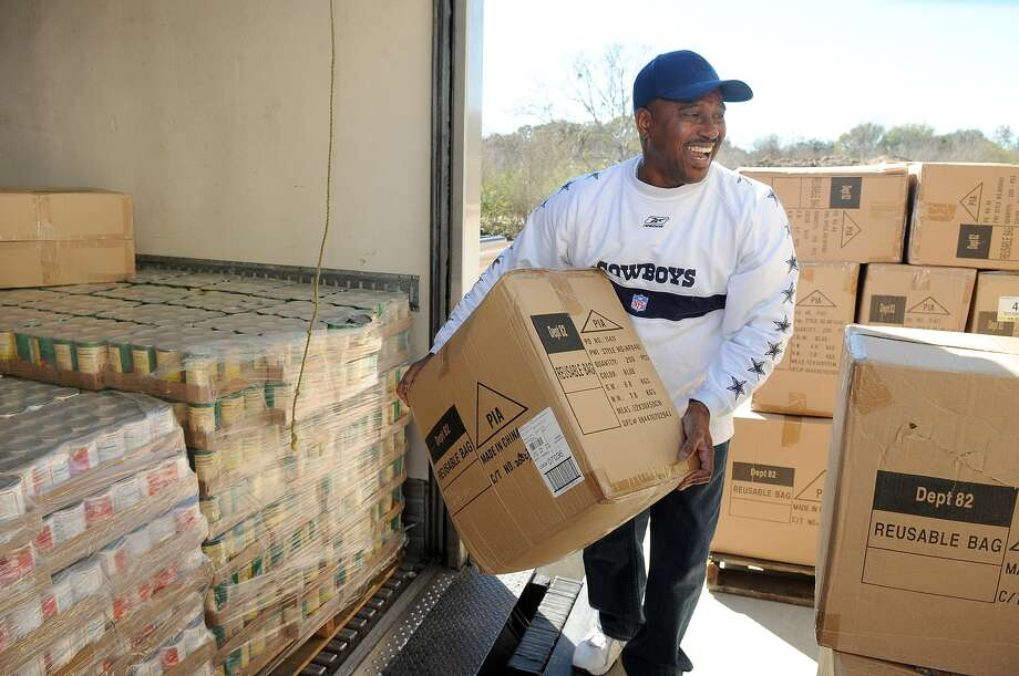 Eltony Hayes of Katy unloads food and support supplies on the loading dock of  the Second Mile Mission Center in Missouri City while volunteering during the center's preparations for its February opening.  Eltony Hayes of Katy unloads food and support supplies on the loading dock of  the Second Mile Mission Center in Missouri City while volunteering during the center's preparations for its February opening. Photo: Jerry Baker, Freelance