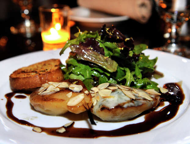 Roasted pear with roasted walnuts and salad is on the appetizer menu at  The Cellar Door Bistro at 439 Main Street in Ridgefield, Conn., Friday, January 18, 2013. Photo: Carol Kaliff / The News-Times