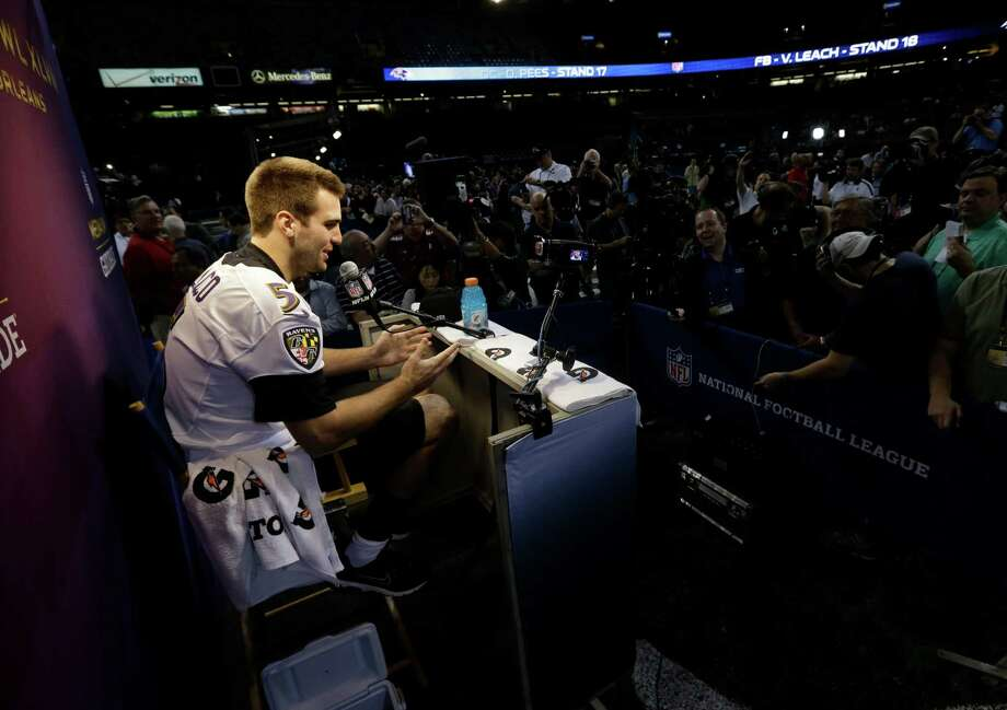 Baltimore Ravens quarterback Joe Flacco is in the spotlight as he addresses the media throng at the Superdome in New Orleans. Photo: Pat Semansky, Associated Press / AP