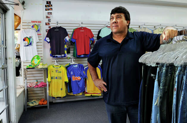 Cleantes Xavier, a Brazilian immigrant, is photographed in his store,  Eliza's, on Main Street in Danbury, Tuesday, January 29, 2013. Photo: Carol Kaliff / The News-Times