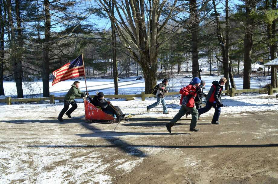 Greenwich Troop 35 Boy Scouts race their Klondike Derby sled around Lake Hillegas at Seton Scout Reservation during a recent Iditarod-style race as part of their recent ValleyForge-themed outdoor skills competition. Photo: Contributed Photo