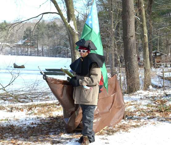 Troop 11 Boy Scout Xiare Person sports a tricorn hat and stands by his sled (which is covered to look like a boat) to try to earn his team extra points as he prepares to take part in the Valley Forge-themed Klondike Derby. Photo: Contributed Photo