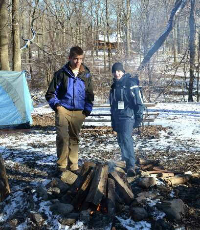 Troop 35 Scouts Kyle Crocco and Zack Weller get a fire started, which will be burn throughout the night. Photo: Contributed Photo