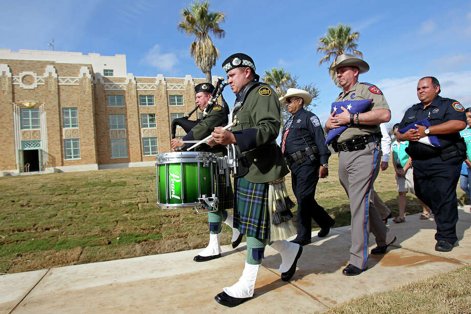 An honor guard brings in the first flags to be hoisted over the newly restored La Salle County Courthouse during grand opening ceremonies in Cotulla last weekend. Photo: Tom Reel, San Antonio Express-News / ©2012 San Antono Express-News