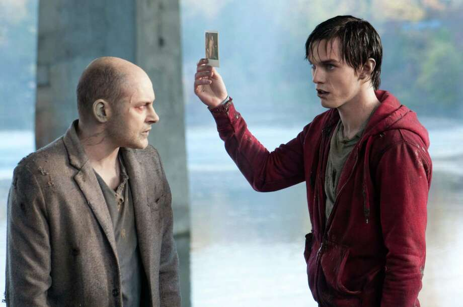 "This film image released by Summit Entertainment shows Rob Corddry, left, and Nicholas Hoult in a scene from ""Warm Bodies."" (AP Photo/Summit Entertainment, Jonathan Wenk) Photo: Jonathan Wenk, Associated Press / Summit Entertainment"