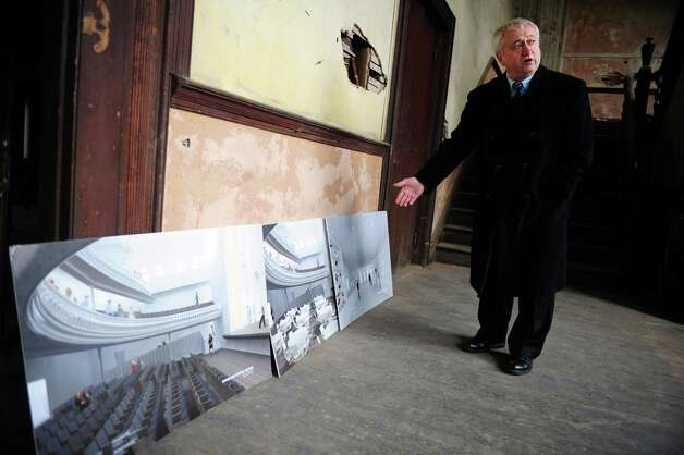 Derby Mayor Anthony Staffieri looks at renovation plans for the city's Sterling Opera House Tuesday, Jan. 29, 2013.  U.S. Rep. Rosa DeLauro recently secured a grant for $150,000 that will go toward interior renovations at the historic theater. Photo: Autumn Driscoll / Connecticut Post