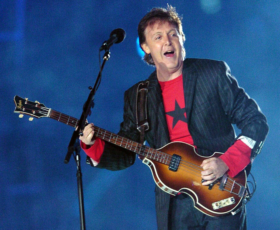 British rock legend Paul McCartney performs at halftime of Super Bowl XXXIX 06 February 2005 at Alltel Stadium in Jacksonville, FL.   AFP PHOTO/Roberto SCHMIDT Photo: ROBERTO SCHMIDT, AFP/Getty Images / 2011 AFP