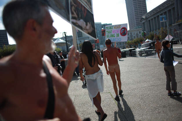 Demonstrators protesting Supervisor Scott Weiner's proposal to restrict public  nudity in the city carry signs in front of City Hall on Tuesday, October 30, 2012 in San Francisco, Calif. Photo: Lea Suzuki, The Chronicle / ONLINE_YES