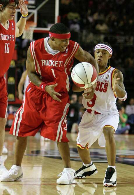 Recording artists Nelly, left,  and Bow Wow fight for the ball during the 2006 All-Star Celebrity Game at the George R. Brown Convention Center. Photo: Mayra Beltran, Staff / Houston Chronicle