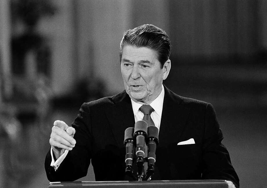 FILE - This April 4, 1984 black-and-white file photo shows President Ronald Reagan faces reporters at the beginning of a news conference in the East Room of the White House in Washington. Second presidential terms are never easy. More often, they're fraught with peril, frequently marred by scandal, failure, hubris, and burnout and souring relations with Congress. (AP Photo/Ira Schwarz, File) Photo: Ira Schwarz, Associated Press