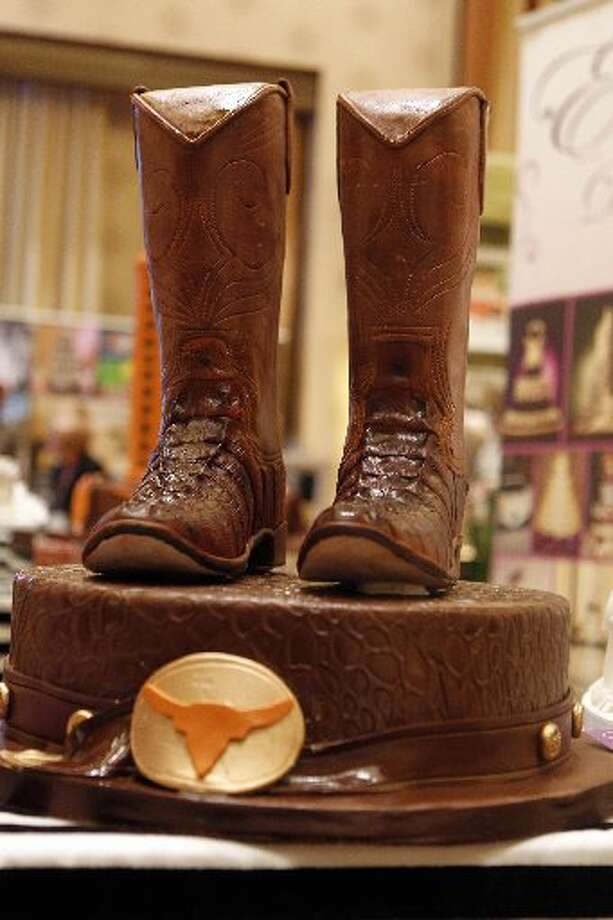 A cowboy boot cake by Edible Designs by Jessie.