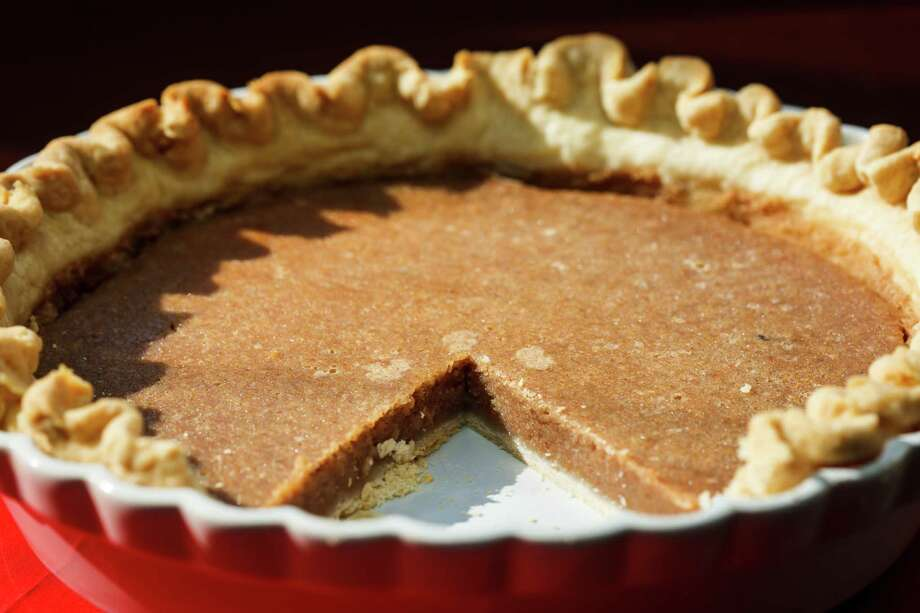 Made with ingredients placed in a food processor, Bean Pie boasts a smooth, custardlike filling. Photo: Michael Paulsen, Staff / © 2013 Houston Chronicle