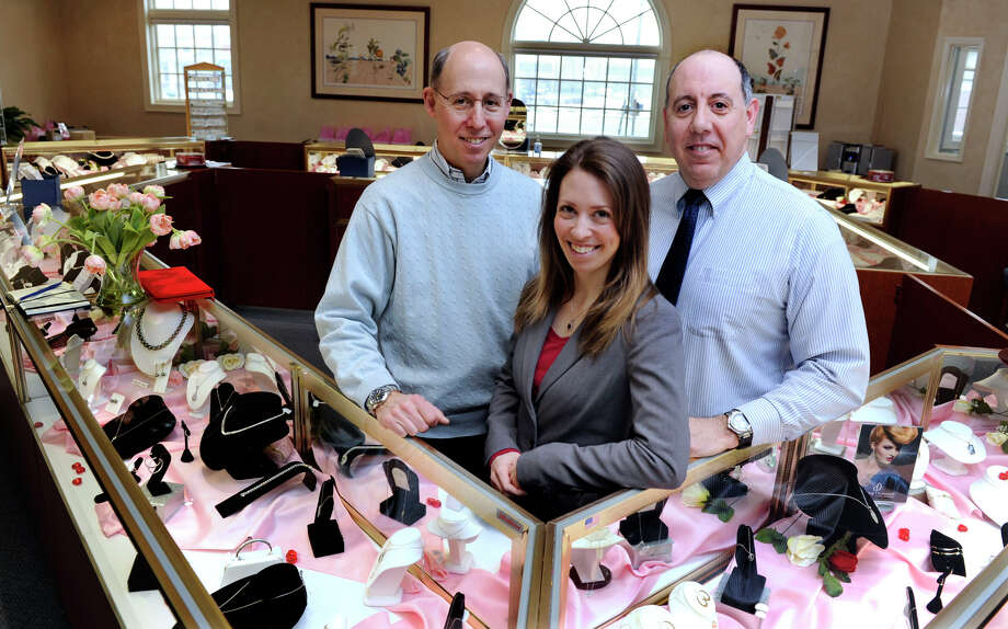 From left, Dennis Janofsky, owner of Quality Gem, his daughter Julie Janofsky, and brother, Rob Janofsky are photographed in the Bethel store, Tuesday, January 29, 2013. Photo: Carol Kaliff / The News-Times