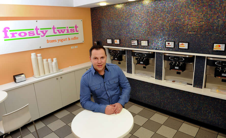 Patrick Jean, owner of Frosty Twist, poses at the store in Milford, Conn. on Tuesday January 29, 2013. The new business features frozen yogurt, coffees, expresso, and Belgian waffles among other things. Photo: Christian Abraham / Connecticut Post