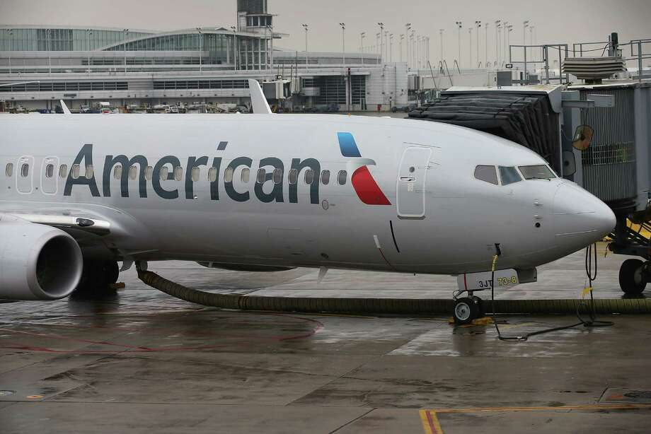 American Airlines' new logo appears Tuesday in Chicago. American's CEO could be chairman of the merged carriers, with US Airways' Doug Parker as CEO. Photo: Scott Olson, Staff / 2013 Getty Images