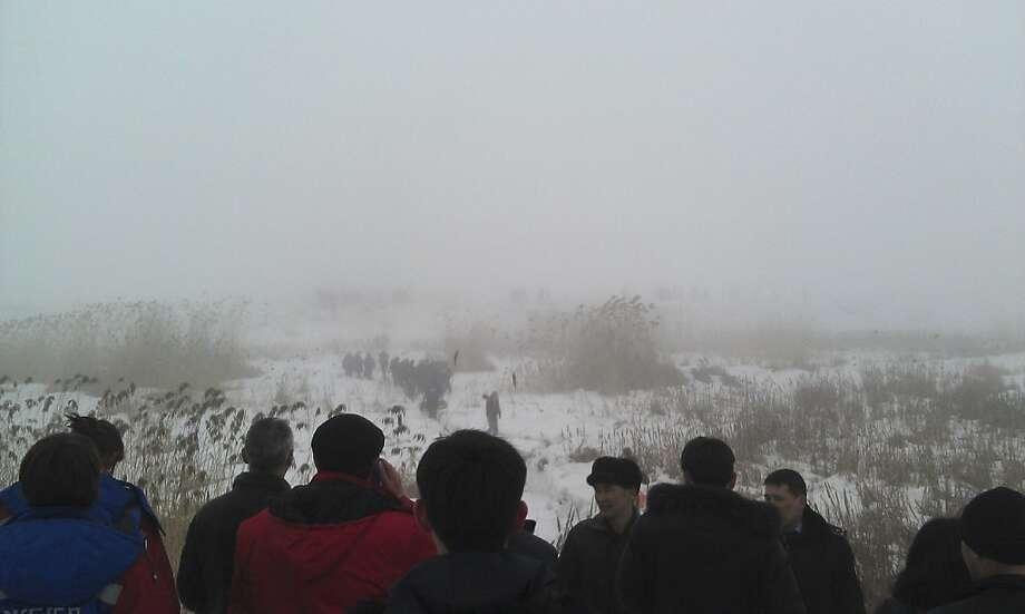 Rescue teams search the area near Almaty, Kazakhstan, where a jet went down in dense fog. Photo: Associated Press