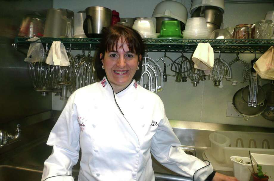 "Cake maker extraordinaire Lisa Maronian, owner of Sweet Lisa's Exquisite Cakes in Cos Cob, is being honored at the 2013 Great Chefs benefit for Greenwich Hospital, which will take place on March 1 at the Westchester Country Club. ""I absolutely love, love what I do,"" says Maronian, who developed her love for baking as a little girl. Photo: Anne W. Semmes"