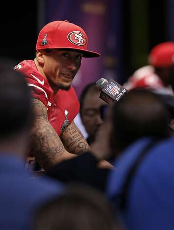 Colin Kaepernick, listening to a reporter's question, was matter-of-fact in his responses. Photo: Carlos Avila Gonzalez, The Chronicle