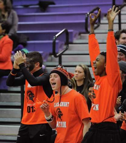 Fans cheer for their team during Tuesday's girls basketball game at Westhill High School on January 29, 2013. Photo: Lindsay Perry / Stamford Advocate