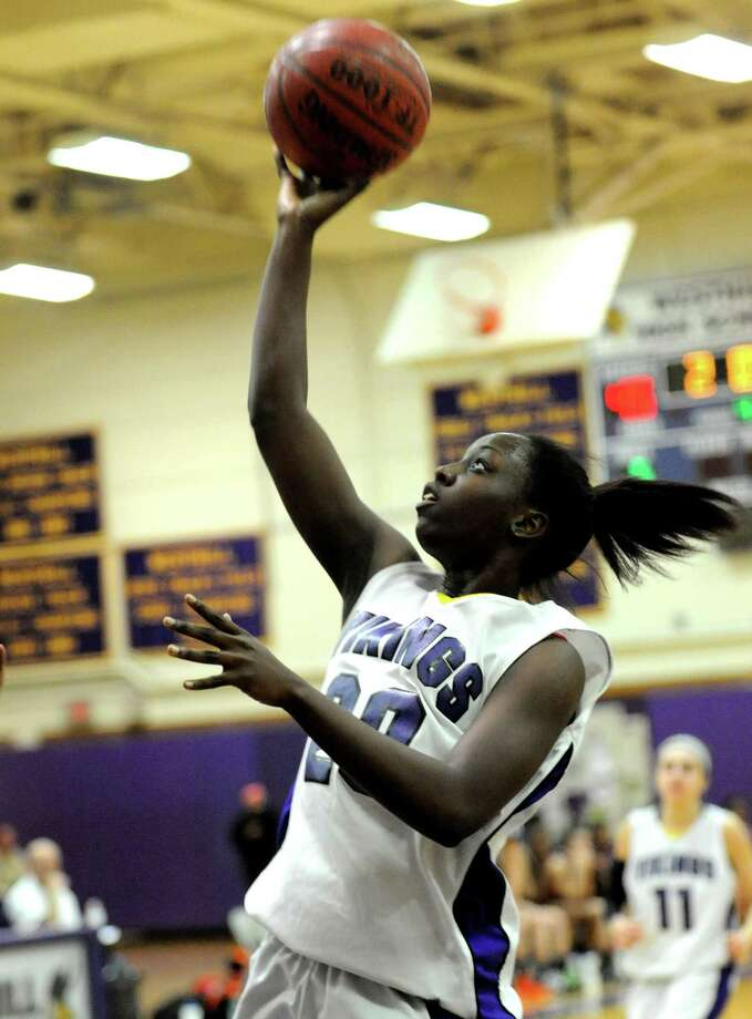 Westhill's Tyler Evans puts up a shot during Tuesday's girls basketball game at Westhill High School on January 29, 2013. Photo: Lindsay Perry / Stamford Advocate