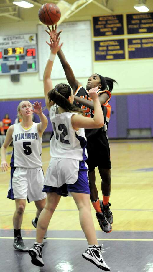 Stamford's Tiana England takes a shot during Tuesday's girls basketball game at Westhill High School on January 29, 2013. Photo: Lindsay Perry / Stamford Advocate