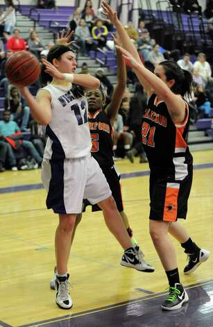 Westhill's Jackie Paasman looks to pass during Tuesday's girls basketball game against Stamford at Westhill High School on January 29, 2013. Photo: Lindsay Perry / Stamford Advocate