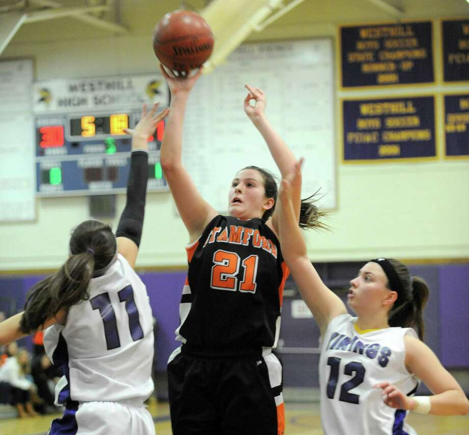 Stamford's Kelsey Santagata takes a shot during Tuesday's girls basketball game at Westhill High School on January 29, 2013. Photo: Lindsay Perry / Stamford Advocate