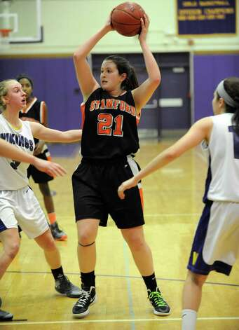 Stamford's Kelsey Santagata controls the ball during Tuesday's girls basketball game at Westhill High School on January 29, 2013. Photo: Lindsay Perry / Stamford Advocate