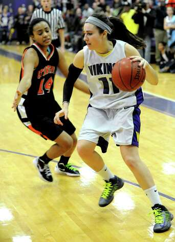 Westhill's Megan D'Alessandro controls the ball during Tuesday's girls basketball game against Stamford at Westhill High School on January 29, 2013. Photo: Lindsay Perry / Stamford Advocate