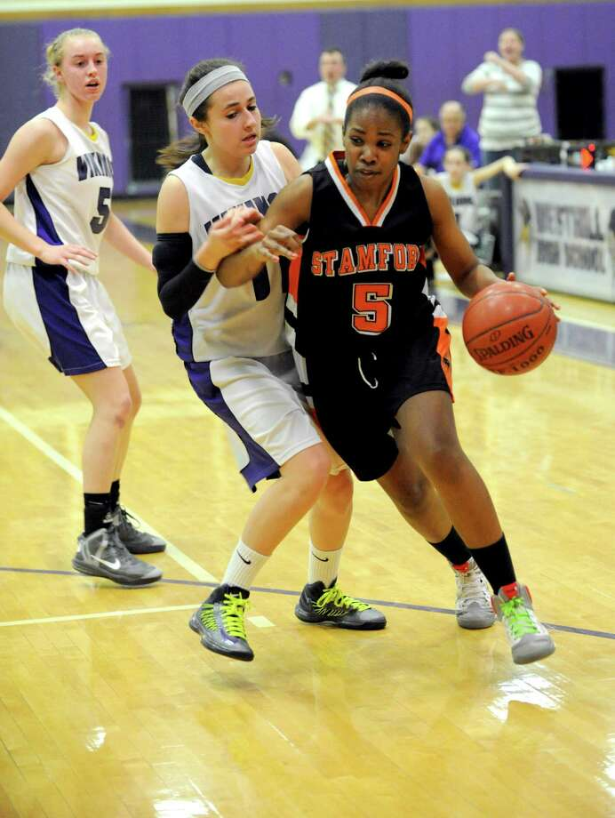 Stamford's Ashyla Cody controls the ball during Tuesday's girls basketball game at Westhill High School on January 29, 2013. Photo: Lindsay Perry / Stamford Advocate
