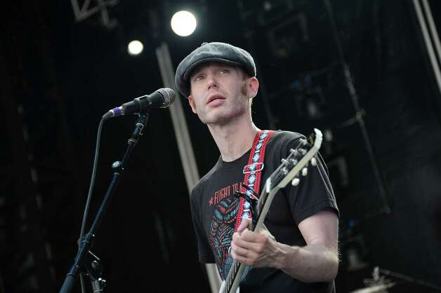 Kasey Anderson, pictured in July, is accused of faking a benefit album and concert series for the 'West Memphis Three' and bilking investors out of hundreds of thousands of dollars. Click through to see the dream lineup Anderson is alleged to have sold in his fraud. Photo: Jason Kempin, Getty Images / 2012 Getty Images