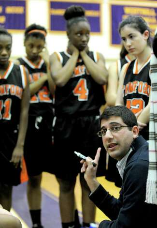Stamford coach Todd Parness speaks to his team during Tuesday's girls basketball game at Westhill High School on January 29, 2013. Photo: Lindsay Perry / Stamford Advocate