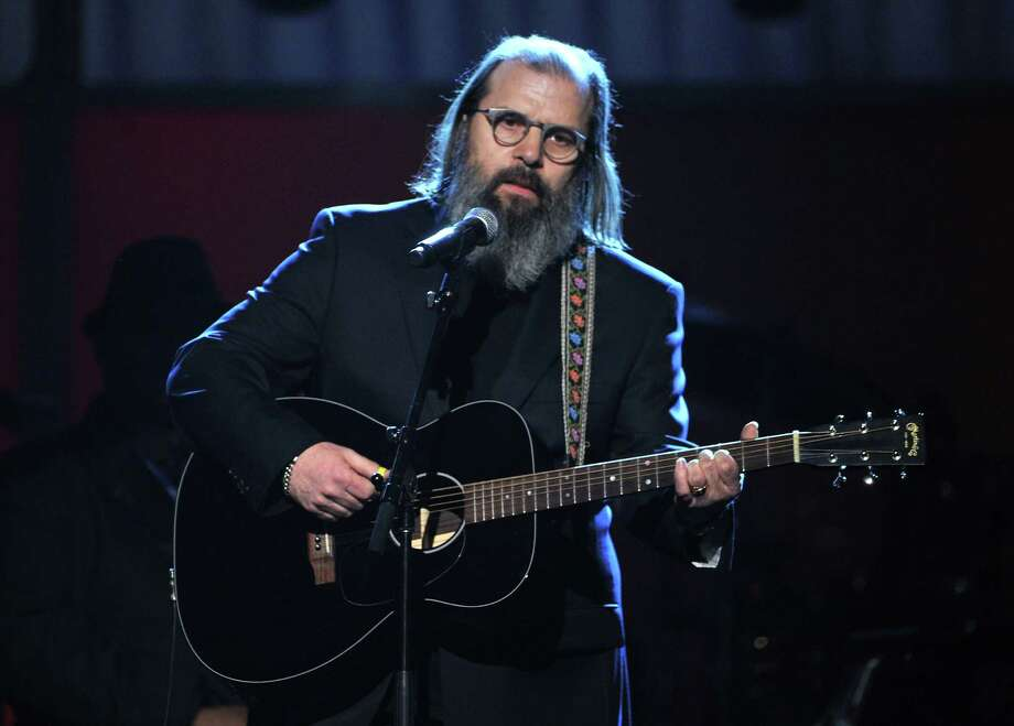 Steve Earle, pictured onstage at the 54th Annual GRAMMY Awards held at Staples Center on Feb. 12, 2012 in Los Angeles. Photo: Kevin Winter, Getty Images / 2012 Getty Images