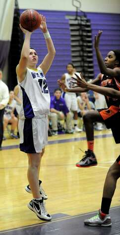 Westhill's Jackie Paasmantakes a shot during Tuesday's girls basketball game against Stamford at Westhill High School on January 29, 2013. Photo: Lindsay Perry / Stamford Advocate