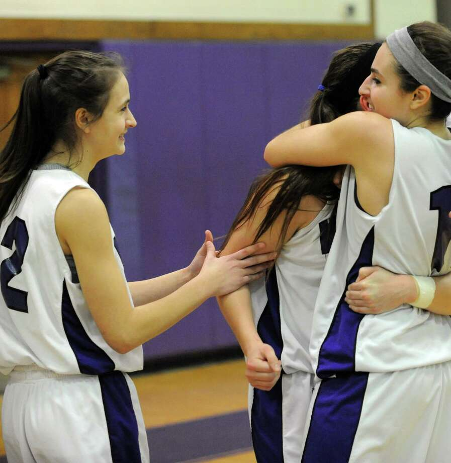 Westhill players celebrate their win over Stamford after Tuesday's girls basketball game at Westhill High School on January 29, 2013. Photo: Lindsay Perry / Stamford Advocate