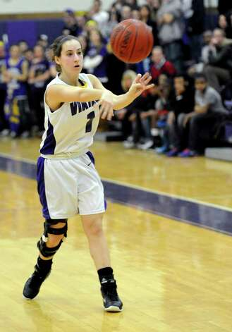 Westhill's Kat Grosso passes the ball during Tuesday's girls basketball game against Stamford at Westhill High School on January 29, 2013. Photo: Lindsay Perry / Stamford Advocate