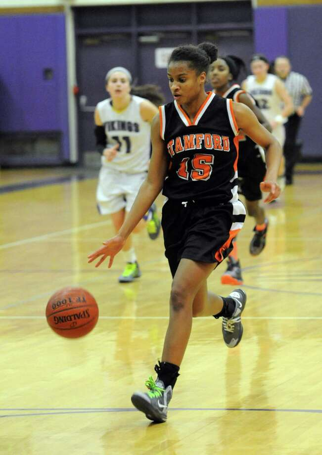 Stamford's Anisa Fortt controls the ball during Tuesday's girls basketball game at Westhill High School on January 29, 2013. Photo: Lindsay Perry / Stamford Advocate