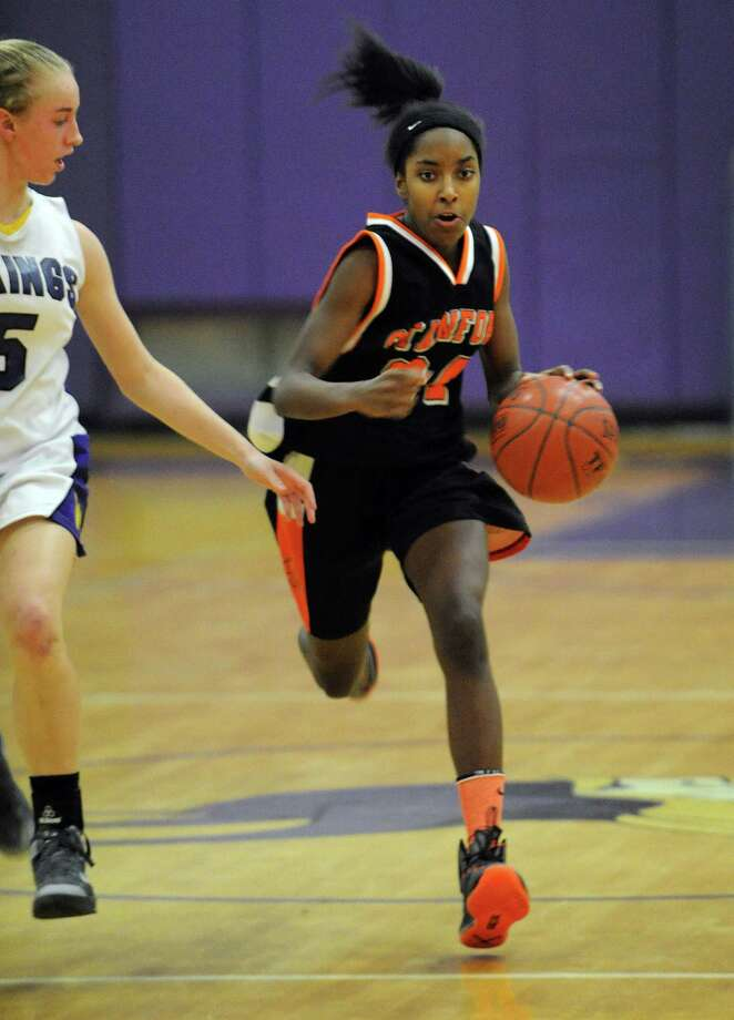 Stamford's Tiana England controls the ball during Tuesday's girls basketball game at Westhill High School on January 29, 2013. Photo: Lindsay Perry / Stamford Advocate