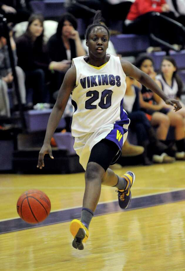 Westhill's Tyler Evans controls the ball during Tuesday's girls basketball game against Stamford High School at Westhill High School on January 29, 2013. Photo: Lindsay Perry / Stamford Advocate