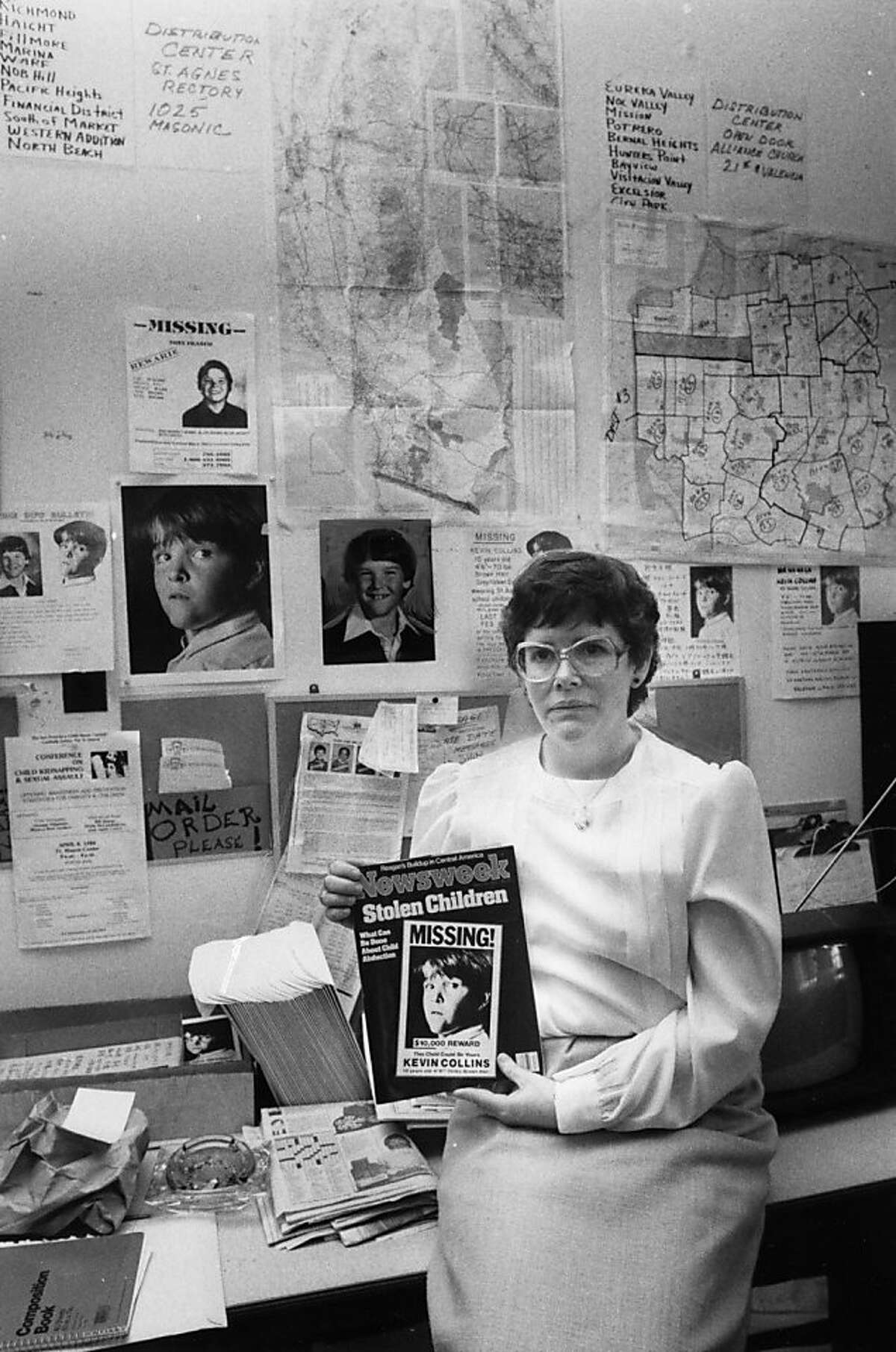 Ann Collins, mother of Kevin Collins, poses with a Newsweek cover depicting her missing son on March 12, 1984. Kevin Collins disappeared in the Haight-Ashbury neighborhood of San Francisco in 1984.