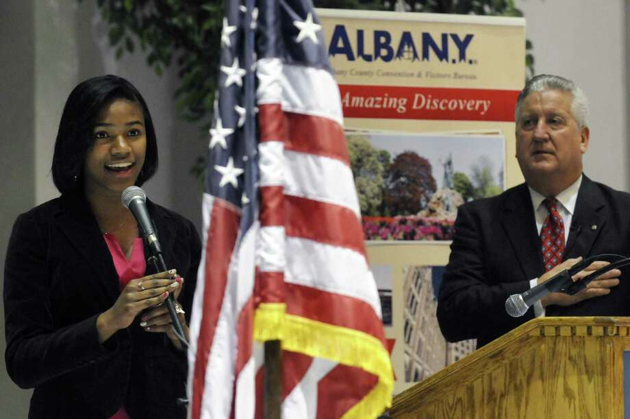 Albant High School student Arielle V. King, left, sings The Star Spangled Banner before Mayor Jerry Jennings gives his annual State of the City at Kiernan Plaza on Tuesday Jan. 29,2013 in Albany, N.Y. (Michael P. Farrell/Times Union) Photo: Michael P. Farrell