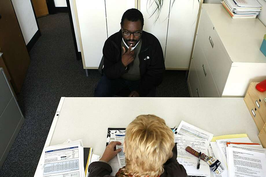 Kenya Wheeler talks to Malla Hadley, a manager at the Department of City and Regional Planning at UC Berkeley, about how he can resume his studies, which had to be postponed during cancer treatment. Photo: Sean Havey, The Chronicle