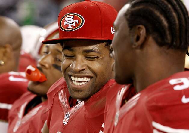 Michael Crabtree (center) laughed with Aldon Smith (right) on the bench as the game wound down. The San Francisco 49ers beat the Green Bay Packers 45-31 at Candlestick Park Saturday January 12, 2013. Photo: Brant Ward, The Chronicle