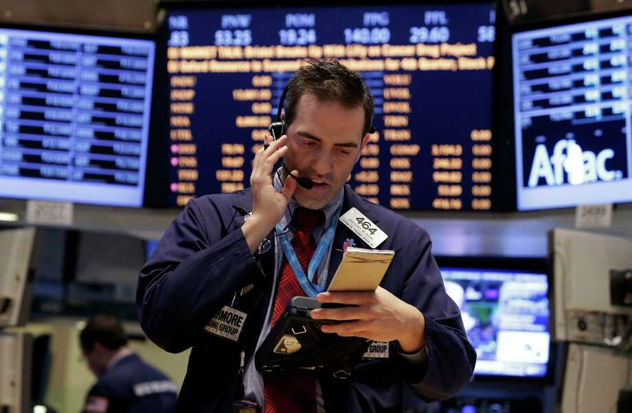 Trader Gregory Rowe works on the floor of the New York Stock Exchange Tuesday, Jan. 29, 2013. Stocks opened mixed on Wall Street, with the Standard & Poor's 500 holding at 1,500. (AP Photo/Richard Drew) Photo: Richard Drew