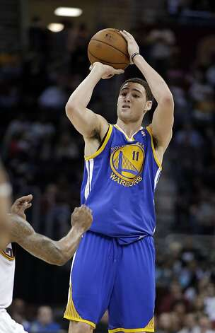 Golden State Warriors' Klay Thompson shoots against the Cleveland Cavaliers in the third quarter of an NBA basketball game Tuesday, Jan. 29, 2013, in Cleveland. Thompson scored 32 points, including 6 for 8 on 3-point shots, to lead the Warriors to a 108-95 win. (AP Photo/Mark Duncan) Photo: Mark Duncan, Associated Press