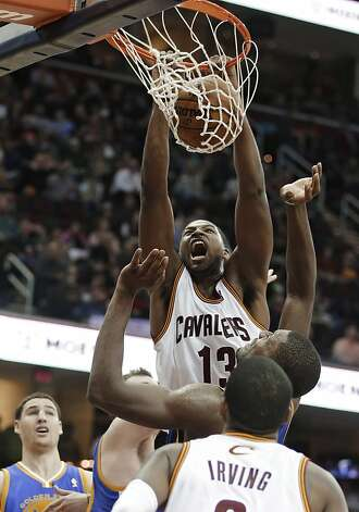 Cleveland Cavaliers' Tristan Thompson (13) dunks against the Golden State Warriors in the second quarter of an NBA basketball game Tuesday, Jan. 29, 2013, in Cleveland. (AP Photo/Mark Duncan) Photo: Mark Duncan, Associated Press